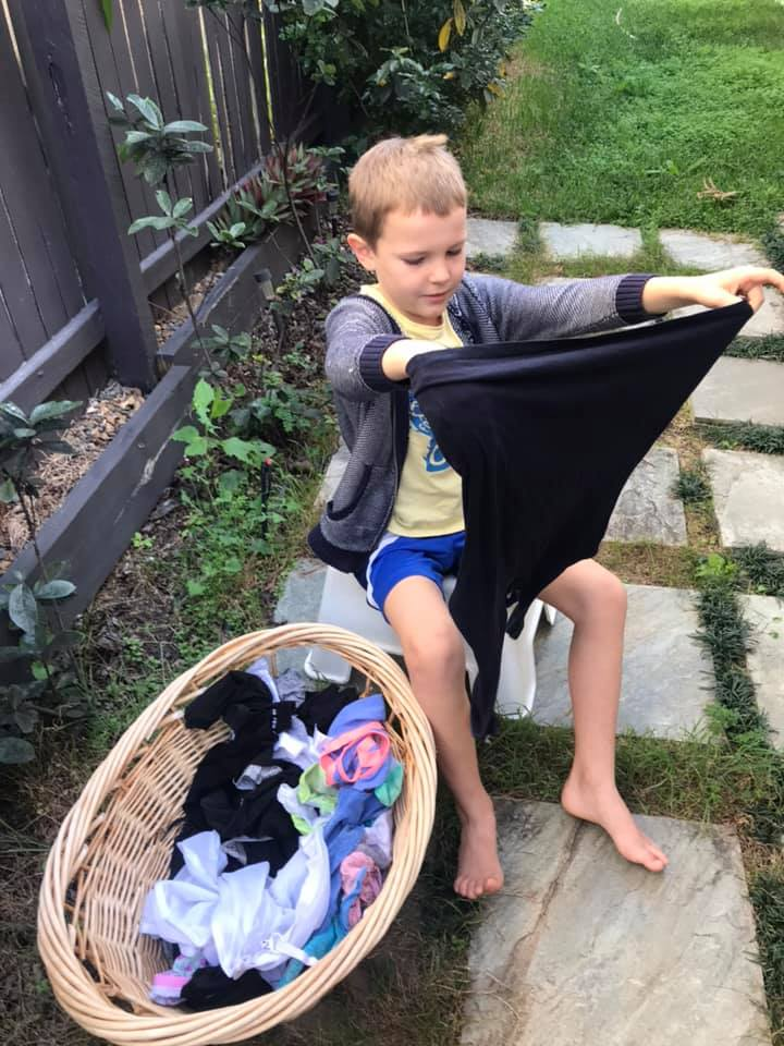 Boy hanging out washing